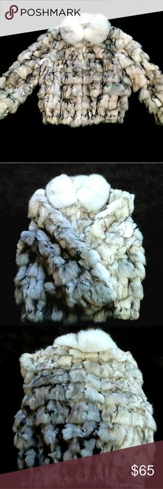Furry coat Its extremely soft not real furr but looks real. Yes it have's little tears on the bottom but you CAN NOT see it far away, The tiny tears on the bottom are inside. overall, the Softies furry cout that keeps you warm in the winter is in excellent condition. Estilo Jackets & Coats