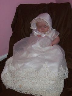Gracie's Christening gown made from my wedding dress and lace from mom and mother-in-law's wedding dresses. Made by my mom :)