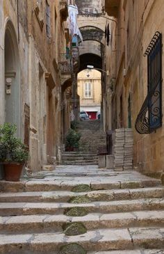 Old street  and picturesque houses of Valletta. Malta Stock Photo