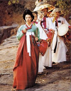 *Note: These are not the costumes for the type of theater, but are representative of the audience culture. The woman in front is wearing a traditional Korean outfit called hanbok.* The theater form is able to keep a lively energy, furthermore, with music in the background created by traditional percussion instruments.