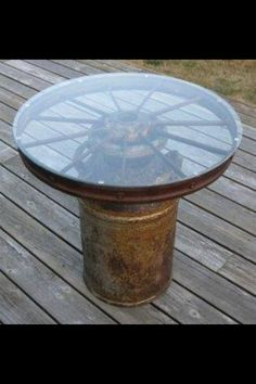 Milk can, wheel and glass= cute country table!