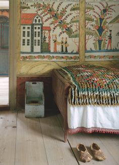 A antique Swedish wall painting,.....The colorful knotted throw ,on the bed,was created to compliment the wall painting.