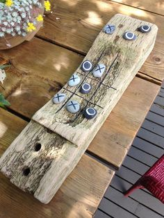 tic tac toe driftwood and pebble board game, gardening