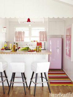 Perfect pink kitchen. Designer: Krista Ewart. Photo: Victoria Pearson. housebeautiful.com  #pinkkitchen #pinkfridge #kitchen