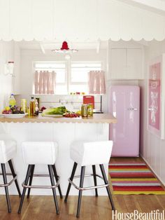 Perfect pink kitchen. Designer: Krista Ewart. Photo: Victoria Pearson. housebeautiful.com  #pinkkitchen #pinkfridge #kitchen