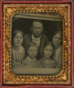 tuesday-johnson:  ca. 1860, [ambrotype portrait of a family at a window] via Harvard University's Houghton Library, Department of Printing and Graphic Art, Harrison D. Horblit Collection of Early Photography