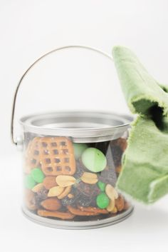 Catch a Leprechaun with this Yummy Leprechaun Bait and Cute Free Printable.  Make this easy St. Patrick's Day treat with pretzels, green M&Ms, green @Hersheys Milk Chocolate Eggs, Peanuts, raisins, and almonds.  I like to package mine in a cute tin or box and add our free printable St. Patrick's Leprechaun Bait tag.  Great for a cute teacher's gift.