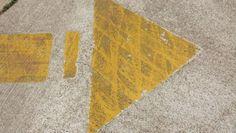 Dirty yellow arrow