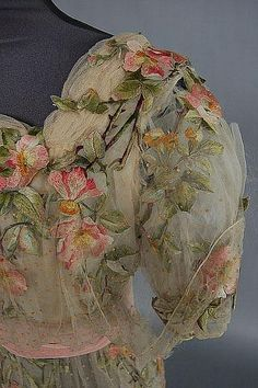A rose embroidered bridal/evening gown circa 1912