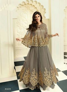 Spread the aura of freshness with this Shilpa Shetty grey net anarkali salwar kameez showing a touch of sensuality. The resham and embroidered work looks chic and perfect for any occasion. Indian Gowns Dresses, Pakistani Dresses, Flapper Dresses, Indian Attire, Indian Outfits, Designer Anarkali, Anarkali Dress, Anarkali Suits, Punjabi Suits