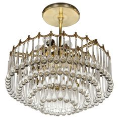 Can be purchased through PICCISTUDIO.   www.piccistudio.com  1940s Hollywood Four-Tier Teardrop Chandelier with Brass Scalloped Border | From a unique collection of antique and modern chandeliers and pendants  at https://www.1stdibs.com/furniture/lighting/chandeliers-pendant-lights/