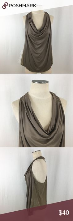 "Trina Turk- Light Brown Cowl Racer Silk Mix Top Lg Trina Turk- Light Brown Cowlneck Racerback Silk Mix Top Size Large. Front is made of 90% Viscose & 10% Elasthane. Back is made of 100% Silk. Front is a little longer than the backside (see pic #3 for side view). Front has a curved hem, back has a straight hem. Length measures about 24"" when laid flat, from label tag (neck)-the bottom of the side (shortest point). Armpit-armpit measures about 19"" across laid flat. Excellent unworn condition…"