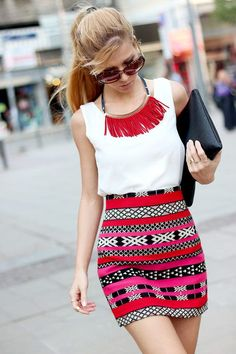 White Tank top / Camisole tucked in to Aztec / Tribal Patterned Skirt