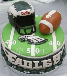 """10"""" yellow cake with buttercream filling covered with MMF.  Helmet..."""