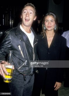 Musician Julian Lennon and actress Charlotte Lewis attend the El Rescate Benefit for Central American Refugees on July 22 1988 at Palette Restaurant in Los Angeles California