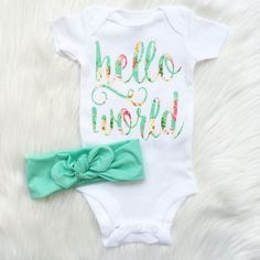 let your sweet babe, say hello to her world, in sweet style! how sweet will that new babe be in this onesie, and headwrap set! you will be the hit