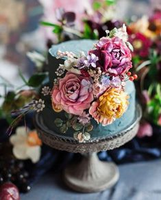 This gorgeous two tiered floral wedding cake is packed with vibrant colour and detail. This gorgeous two tiered floral wedding cake is packed with vibrant colour and detail. 2 Tier Wedding Cakes, Floral Wedding Cakes, Wedding Cake Designs, Purple Wedding, Colourful Wedding Cake, Jewel Wedding Cake, Wedding Cake Vintage, Gold Wedding, Wedding Flowers
