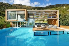 12 Modern Pools: Spa House by Metropolis Design in Cape Town, South Africa has a deck that's designed to look like a raft.And, there is actually a spa located below the water level of the pool, with a direct view into it through large glass windows.