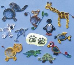 Doing quilled animals to use as decorations on food labeling and other signs for my friend's baby shower. Did the elephant from this one, as long as you have the basic quilling skills, it's not too difficult to just look at the picture and figure it out...no need to pay for a tutorial!