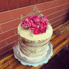 Naked cake, vanilla buttercream,  natural almost nude cake with roses and carnations fit for a garden party.