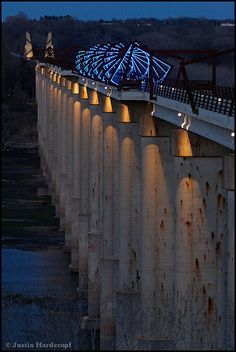 Madrid High Trestle Bridge: The 13-story high bridge over the Des Moines river is a half mile long and was built on concrete piers that previously held a railroad bridge. 41 steel frames form a twisting tunnel.