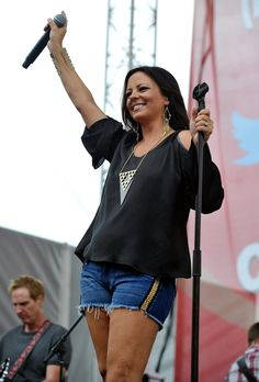 Sara Evans, NASHVILLE, TN - JUNE 06: Sara Evans performs on the Chevrolet Riverfront Stage during the 2013 CMA Music Festival on June 6, 2013 in Nashville, Tennessee. (Photo by Frederick Breedon IV/WireImage), 2013