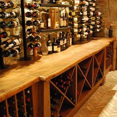 """""""Plenty of wine sitting on the countertop we did for this wine cellar"""" 