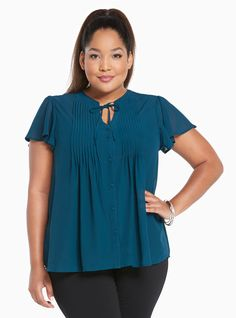"""<div>Monday mornings don't always have to be awful; this top proves it. Perfect when layered with our Foxy, the sheer teal blouse is all dressed up with a pleated button front and tie neck</div><div><br></div><div><b>Model is 5'10"""", size 1</b></div><div><ul><li style=""""LIST-STYLE-POSITION: outside !important; LIST-STYLE-TYPE: disc !important"""">Size 1 measures 28 3&#..."""