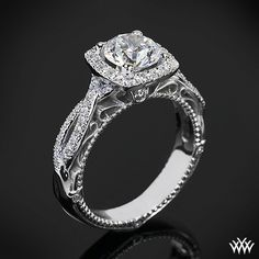 This Diamond Engagement Ring is from the Verragio Venetian Collection. It features 0.30ctw of Round Brilliant Diamond Melee (F/G VS) that enhance the round or cushion diamond center of your choice. The width tapers from 4.0mm at the top down to 3.5mm at the bottom. Select your diamond from our extensive online diamond inventory. Please allow 4 weeks for completion. If you have any questions regarding this item then please contact one of our friendly diamond and jewelry consultants at…