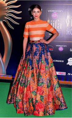 #CropTop With Lehenga.  Crop top or jackets work as blouses and the skirts as lehengas. It can be a perfect mehendi dress for a bride or her bridesmaid.Crop top with a pleated floral skirt or a sequined a-line skirt or any other shape looks beautiful and quirky.