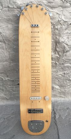 stereotank transforms a blank skate deck into lap steel guitar