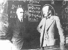 Max Planck (r) and Niels Bohr in front of Maxwell's equations