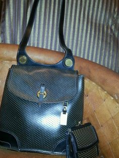 Dooney & Bourke  cabrio perforated leather purse.  Black and matching wallet/ #DooneyBourke #ShoulderBag