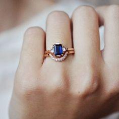 Blue Sapphire Rose Gold love Ring by @annasheffield and available to try on in @beaumade ✨Gorgeous photo via @bona_drag #abouttosayyes . . . #beaumade #engaged #engagamentring #ido #bride #bridetobe #wedding #shesaidyes #justsaidyes #howheasked #love #ringoftheday #alternativeengagementring #uniqueengagementring #ringselfie #ringfie #ringbling #ringblings #blingbling #bling #ohwowyes #gemhuntrings #alternativeengagementring #trybeforeyoubuy #dreamring #weddingringwednesday