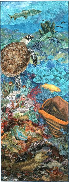 Created for my first book, Free-Style Quilts, this quilt is a slice of a coral reef from the sunlit zone at the top to the dark and dangerous bottom. Species include barracuda, sea turtle, parrotfi…