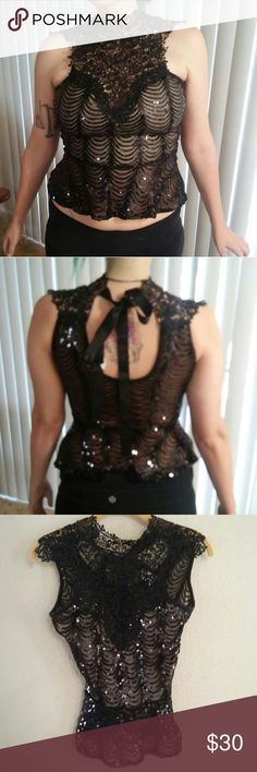 Sequin & Lace Style Top Gorgeous black top * Sheer in some areas, sequins throughout * Beautiful crochet lace style * Ties in back * Size S * 100% nylon * In great condition * Offers accepted Janice Tops Blouses