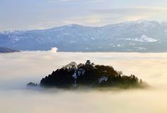"""Ono Castle (大野城) in Echizen, Japan was originally built in 1586. It's known as one of Japan's """"floating"""" castles due to the clouds that cover the base of its mountain."""