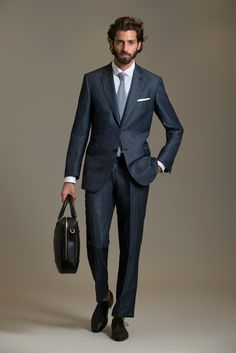 Brioni, nice and clean! Can't wait to own a suit like this.