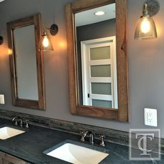 Soapstone Counters With Oil Rubbed Bronze Faucets and Custom Hickory Mirrors