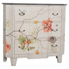 """Display a vase of lush blooms or stow board games and DVDs in this artful mahogany chest, showcasing a lovely hand-painted floral motif.   Product: ChestConstruction Material: MahoganyColor: White and multiFeatures:  Three drawersHand-paintedDimensions: 48"""" H x 52"""" W x 18"""" DCleaning and Care: Wipe with a soft cloth"""