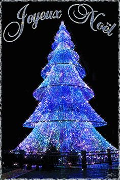 Joyeux Noël #noel joyeux noel sapin illumination lumieres scintille gif anime hiver fetes