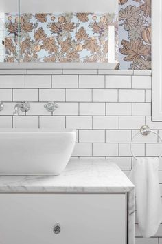 Striking pairing of black grout and white tiles: Grout as a design feature. Grout is no longer purely a mundane, if essential, element of pulling a bathroom together. People are seeing the possibility of using grout creatively in their bathrooms to show off the pattern of how a tile is laid, highlight specific tile types and use contrasting grout as a great modern spin on the traditional subway tile.