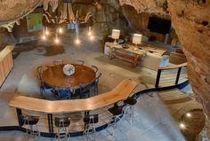 """Most romantic in Arkansas: """"Beckham Creek Cave Lodge"""" Tuck yourself in under a ceiling of stalactites in a 6000-square-foot cave that's full of modern, luxurious amenities. Nestled into the Ozark Mountains near Buffalo National River, the unique resort's """"suites"""" start at a steep $1,200 a night. But with four private rooms and as many bathrooms, maybe make it a group couples' getaway. RELATED: 17 Long-Weekend Getaways For When You Just Want to Get the Eff Out of Town"""