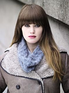 LINK from Frost Collection (ZB119) features over fifteen garments and accessories all in the exquisite Frost. The collection features simple to make long length cardigans, shrug, poncho and sweaters to keep cosy in the cold weather. The yarn features a beautiful mélange core with a subtle metallic look all cocooned in a soft halo | English Yarns