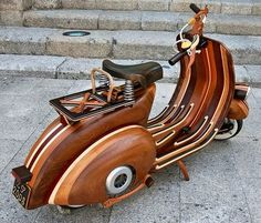 Crazy cool wooden scooter….   What do you think instead of the Pink Vespa???