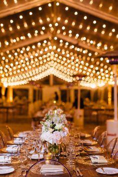 Elaine Palladino; miami wedding; glamorous miami wedding; formal gardens; Vizcaya; clear tent; clear tent with fairy lights; clear tent with string lights; ghost chairs; wooden tables;