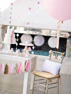 Tassel garlands are a huge party trend. It's easy to make your own with some tissue paper or sparkling mylar, scissors and string.