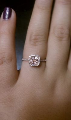 Gorgeous ring - Its a peach/champagne sapphire surrounded by diamonds set in rose gold. I like that its square and the jewel fits the entire cushion cut. I'd be curious about how it fits with a wedding band, though.   by EidelPrecious on Etsy.com,