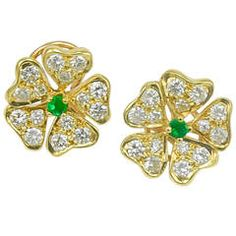 """Tiffany & Co. Vintage 1980s Clip-on Earrings Diamond, Emerald, 18k Gold Bright five-leaf clover earrings, made and signed by TIFFANY & CO. 18K yellow gold, set with diamonds and a center faceted emerald. 1/2"""" diameter. Lovely and feminine"""