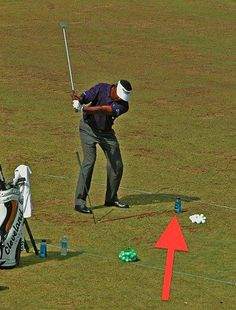 If you want to swing a certain way, make yourself swing that way. If you're taking the club too inside on your backswing, place the water bottle just inside the ball. It'll force you to swing outside of it.